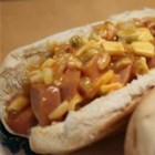 Baked Hot Dog Sandwiches - Chopped hot dogs and traditional toppings are mixed together and stuffed into buns before going into the oven in this variation on the all-American tradition.