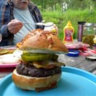Dad's Favorite Detroit-Style Roquefort Burgers - An easy, vintage recipe for beef burgers stuffed with Roquefort cheese and served on heated buns with lettuce, tomato, and onion makes a savory grilled meal.