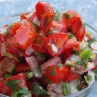 Cinco de Mayo Salsa Cruda - Cherry tomatoes, combined with hot chiles, onion, cilantro, and mint make a zesty and flavorful fresh salsa perfect for your next Mexican fiesta!