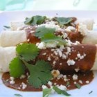 Chicken Enchiladas With Mole Sauce - These authentic chicken enchiladas with mole sauce were inspired by a dish served at Seattle's La Carta De Oaxaca restaurant. Chocolate and dried chiles make a rich and flavorful sauce that tops the moist and tender chicken enchiladas.