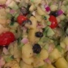 Mom's Italian Potato Salad - Dressed with a light red wine vinaigrette, the vegetables in this potato salad really stand out. Cucumber and celery give the salad a great crunchy texture, while the olives lend a tangy saltiness that makes this Italian potato salad pop with flavor.