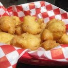 Clam Fritter Snacks - Clams dipped in egg and baking mix, then fried to a golden brown.