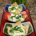 Spinach, Artichoke and Crab Wontons - Crispy wonton cups are filled with a cheesy, peppery combination of spinach, artichoke, and crab.