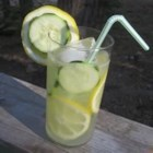 Refreshing Summer Cucumber Lemonade - This is the most refreshing summer beverage you've ever tasted. It's unique in the way it infuses the flavors of fresh garden cucumbers, the tangy brightness of fresh lemons, and the lightness of an effervescent lemon-lime soda to create a delicious thirst quenching Southern summer ade. Perfect when relaxing on your front porch swing on a warm summer night.