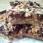 Trail Bars - I have used raisins in place of dates, and used chopped walnuts and pecans instead of almonds; up to you.  The perfect snack and energy booster for a day in the great outdoors, or any occasion.  Warning:  Addictive!