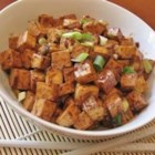 Chinese Mabo Tofu - Ground pork and firm tofu take on the flavors of hot bean sauce, garlic, ginger, and sesame oil in this quick-cooking dish.
