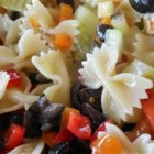 Easy Italian Pasta Salad - Bow-tie pasta and prepared Italian dressing are tossed with tomatoes, bell pepper, cucumber, olives, and celery in this pasta salad recipe.