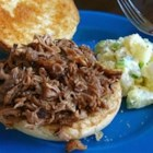 Sweet and Savory Slow Cooker Pulled Pork - Low and slow defines this recipe for shredded pork, marinated overnight in root beer, rubbed with warm and flavorful spices, then slowly simmered for 6 hours in a slow cooker in a cooking sauce with more root beer, balsamic vinegar, and a shot of whiskey. The meat is shredded and served on soft buns.