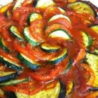 Disney's Ratatouille - A beautiful deconstructed ratatouille is composed of sliced colorful vegetables arranged over a garlic-infused tomato sauce and baked. It's like the one in the animated movie.
