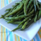 Pan Fried Green Beans - Garlic powder, onion powder, salt and pepper are caramelized with fresh green beans, lending a grilled flavor to the tender-crisp beans.