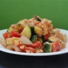 Zucchini for Lunch - This is one of my favorite dishes to make whenever I have some zucchini on hand. Some people tell me that it doesn't look so good, but once you try it, I think you'll like it. The mixture of vegetables, eggs, peppers and tomato sauce gives it color, besides some protein. You might like the taste better than the looks of it. Give it a shot, it won't kill yah!!