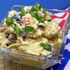 Lela's Fourth of July Potato Salad - This potato salad, filled with green and black olives, chopped pickles, and hard-cooked eggs, makes enough for 30 to 40 people (but the recipe also includes directions for a smaller batch)!
