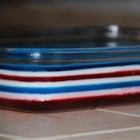 Fourth of July Layered Gelatin - Festive red, white, and blue gelatin layered squares will be a hit dessert at your 4th of July meal.