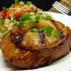 Pineapple Grilled Pork Chops - Pork chops marinate overnight in a sweet and savory Asian-inspired mixture of pineapple juice, brown sugar, and soy sauce before they're grilled and served with grilled pineapple slices.