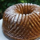 Poppy Seed Bundt Cake III - This cake is very easy to make and tastes wonderful. Yellow cake mix with poppy seeds added and flavored with almond extract.