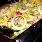 Campfire Veggies - An easy, filling side dish for barbecues or camping can be made by cooking potatoes and vegetables in foil packets.  This is an easy recipe for your campfire, BBQ Grill, or oven.