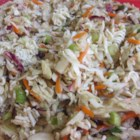 Dad's Asian Slaw - Bagged coleslaw mix is combined with crunchy dry ramen noodles, sunflower seeds, almonds, green onions, and a simple sweet vinaigrette for a tasty Asian-inspired coleslaw.