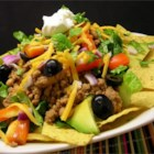 Dana's Taco Salad - Ground turkey and lentils are cooked with taco seasoning before being tossed with lettuce, avocado, tomatoes, olives and kidney beans for a delicious take on taco salad.