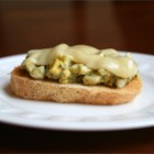 Gourmet Egg Salad Sandwich - This egg salad sandwich is loosely based on an open-faced egg salad sandwich served at a local bistro. The unexpected pairing of pesto and Jarlsberg compliments the egg salad tremendously. The amounts of each ingredient can vary depending on taste.
