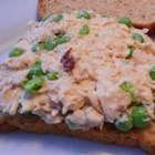 Spicy Mexican Tuna Salad - Make a Mexican-style tuna salad in just a couple of minutes with this easy recipe. Chipotle peppers and green peas add flavor and texture. Serve with tortilla chips.