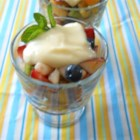 Saucy Summer Fruit Salad - Peaches, berries, bananas, and a creamy orange sauce combine summer's fruitiest flavors in a single fruit salad!
