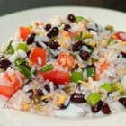 Santa Fe Rice Salad - This flavorful salad is composed of black beans, rice, fresh tomatoes, Cheddar cheese and green onions dressed with a jalapeno vinaigrette and topped with ripe avocado.  Try to use garlic vinegar in the dressing, if you can find it!