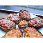 Mushroom and Tomato Bruschetta - A juicy fresh mushroom and tomato topping sets this easy bruschetta recipe apart. The cheese-topped appetizers are broiled and served warm.