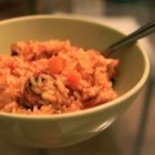 Jambalaya - Chicken and andouille sausage is simmered with rice and Cajun seasonings in this spicy jambalaya recipe.