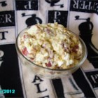 Mamabear's Potato Salad - A hearty potato salad filled with crumbled bacon, eggs, and Cheddar cheese is perfect for your next barbeque. For best flavor, let it chill overnight.