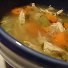 Portuguese Chicken Soup II - Elegant. Garnish with a slice of lemon and a mint leaf.