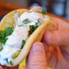 Pablito's Chicken Tacos - A delicious twist on a Mexican favorite, Pablito's Taqueria's homemade tortillas with chicken and kale filling topped with sorrel sour cream are a delight to eat!