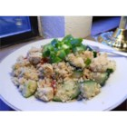 Rosemary Chicken Couscous Salad - Assemble this light, refreshing couscous-chicken salad in minutes using pre-cooked chicken, chopped cucumber, sun-dried tomatoes, Kalamata olives, and crumbled Feta cheese. An easy vinaigrette dressing made with white balsamic vinegar, lemon juice, olive oil, and fresh rosemary adds an enticing herbal accent.