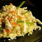 Ramen Cabbage Salad - In this salad, shredded green cabbage is tossed with dried ramen noodles and nuts in a simple sweet and sour vinaigrette.