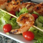 Sweet and Spicy Grilled Shrimp - Basting shrimp on the grill with a sauce made with honey and chile-garlic sauce delivers flavorful results.