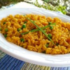 Cuban-Style Yellow Rice - Fragrant, flavorful, and a staple side dish in Cuban cuisine, yellow rice takes its color from annatto, a natural coloring made from the seeds of a small Central American shrub. Add peas and garnish with pimento slices for authentic Caribbean style.