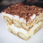 Tiramisu II - This tiramisu recipe features rum and coffee-soaked ladyfingers layered with mascarpone custard and whipped cream.