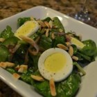 Wilted Spinach and Almond Salad - Fresh spinach is wilted with a warm sesame oil dressing and topped with toasted almonds and pan-fried onions for a flavorful warm salad.