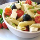 Penne, Tomato, and Mozzarella Salad - Enjoy the bright, fresh flavors of tomato and basil in this quick and easy dish. Toss hot pasta with sauteed garlic and scallions; add chopped tomatoes, mozzarella, Parmesan, basil and olives.