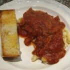 Montigott - Turkey Italian sausage is cooked in a red sauce using a slow cooker, then spooned over cheesy baked noodles.