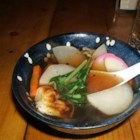 Zoni - Visit a Japanese grocery store to gather the ingredients for this delicious clear broth. Kelp, bonito and sake impart a delicate flavor to the soup. Strain the liquid and serve with simple slices of spinach, citron and fish paste.