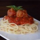 Healthier Italian Spaghetti Sauce with Meatballs - A traditional family favorite, spaghetti and meatballs gets a healthier twist with whole wheat bread crumbs and fresh parsley.