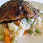 Blackened Catfish and Spicy Rice - Buttery pan-fried catfish fillets are served over a bed of spicy white rice in this quick dinner.