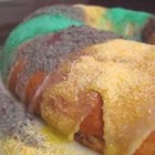 Slim Fit King Cake - This colorful king cake has less sugar then the classic treat and uses reduced fat margarine instead of butter. Banana and pineapple chunks give the cream cheese filling a fun and fruity twist.