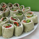 Ham and Fresh Basil Pinwheels - Italian standbys--like fresh basil and sun-dried tomatoes--roll up here with ham, cheese and red-leaf lettuce. You simply refrigerate and slice when ready to serve.