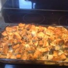 Aunt Jewel's Chicken Dressing Casserole - Chicken breast topped with creamy soups, a broth and stuffing mixture, and baked.