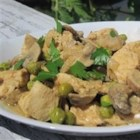 Keon's Slow Cooker Curry Chicken - Chunks of chicken breast cook slowly in a creamy, curry-flavored sauce with coconut milk, peas, and mushrooms for a nicely spicy take on a slow cooker chicken dish. Serve over rice or with hot naan bread.