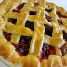 She's My Blackberry Pie - Lattice-topped blackberry pie gets a tangy twist with a squeeze of lemon juice. Bring this pie along to your next gathering and it will be the hit of the party.
