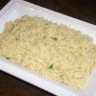 Parmesan Garlic Orzo - Minced garlic is cooked in butter and tossed with orzo pasta, Parmesan cheese, and a little milk in this quick and easy side dish.