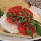 Caprese Salad Sandwiches - Red, ripe tomatoes, mozzarella cheese, and fresh basil leaves make a wonderful summer sandwich when combined with dark artisan bread and white truffle oil.