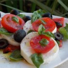 Simple Caprese Salad - Fresh slices of red ripe tomato alternate with mild mozzarella cheese and pieces of roasted red pepper in an easy Italian salad that's great for a light main dish on a hot summer day.